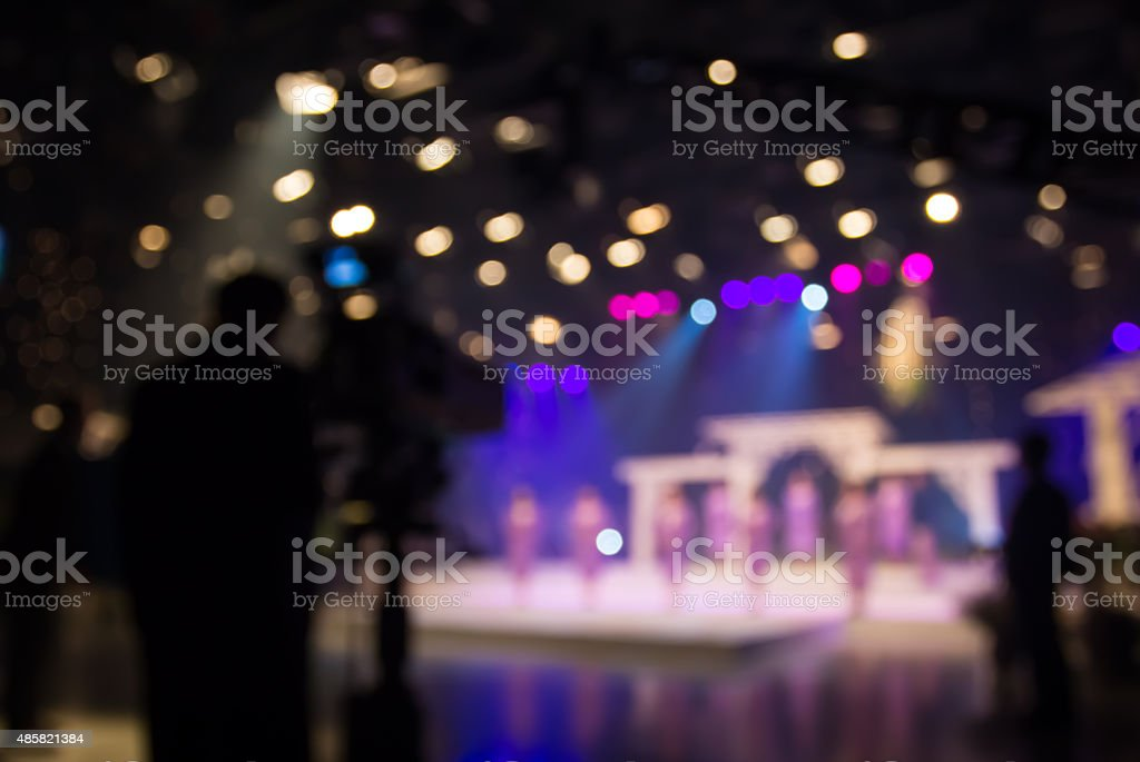 Actress or singer in studio of television station with camera stock photo
