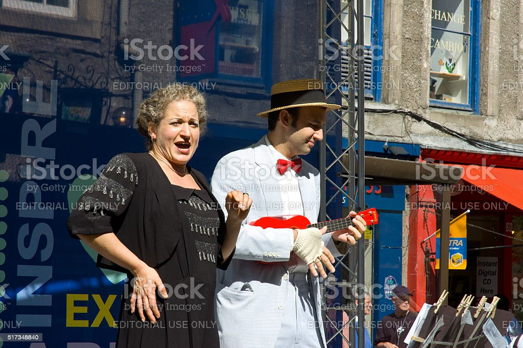 Actress sings on Royal mile in Edinburgh stock photo
