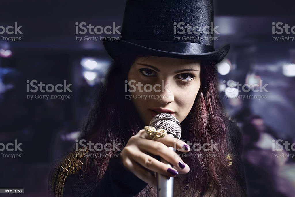 actress with microphone royalty-free stock photo