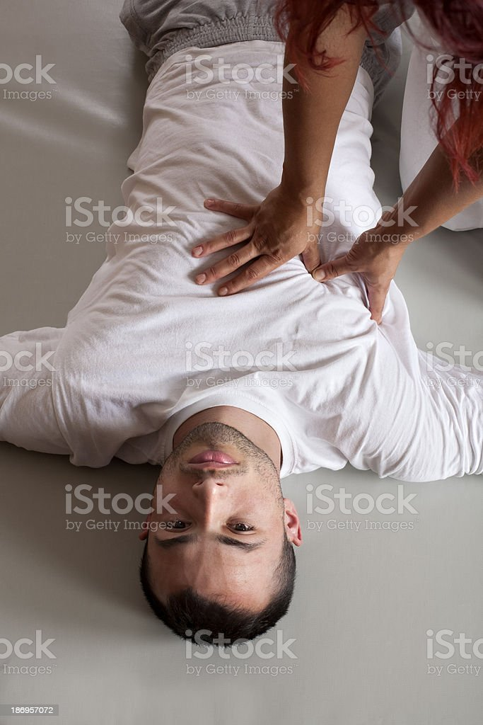 Acupressure massage of male torso stock photo