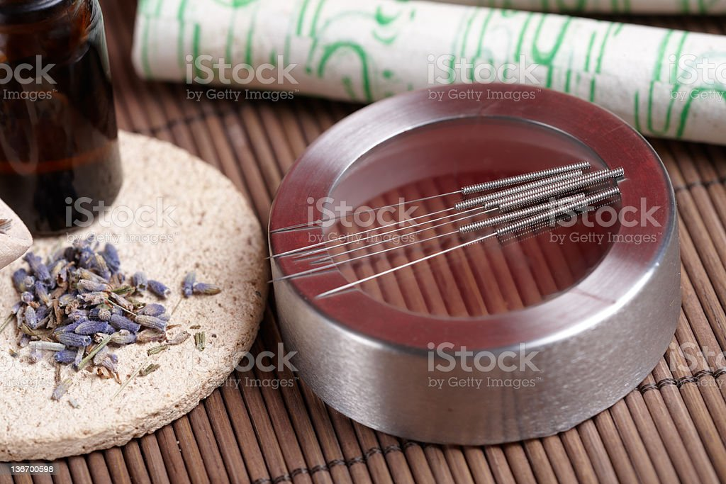 Acupuncture needles, moxa sticks and lavender petals stock photo