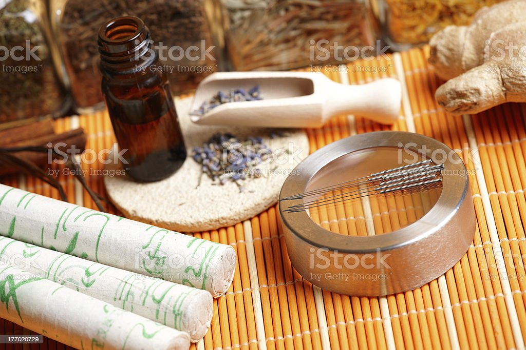 Acupuncture needles, moxa sticks and lavender petals royalty-free stock photo