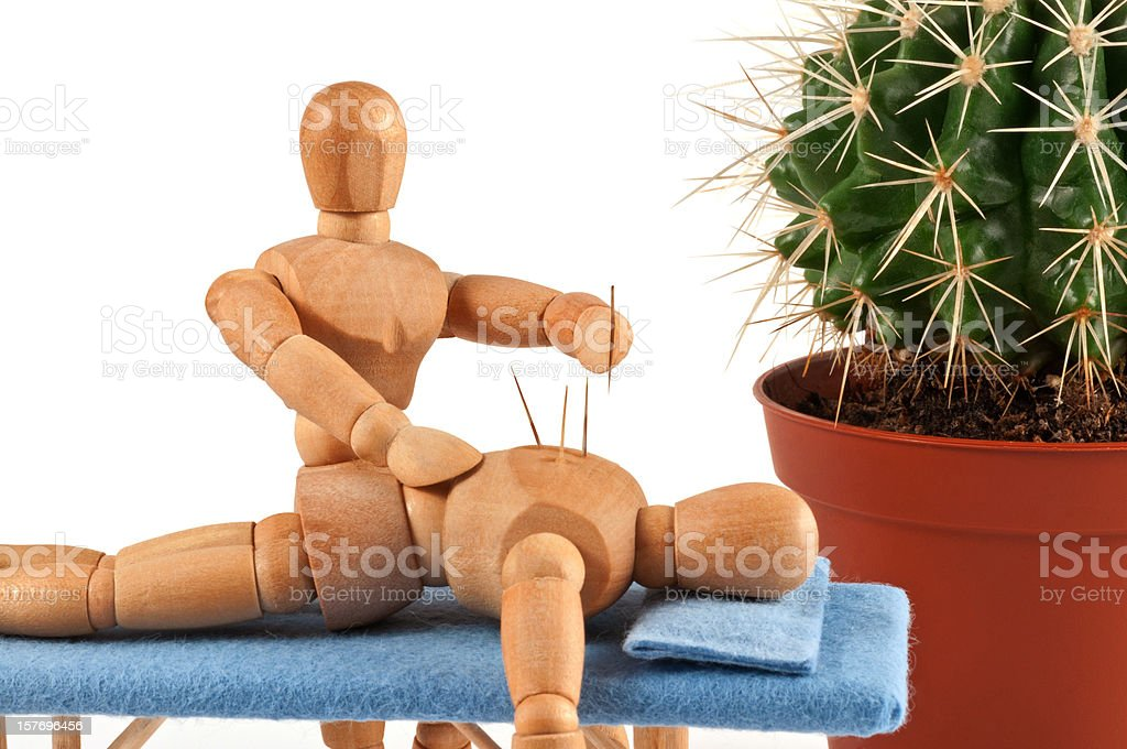 Acupuncture - wooden mannequin with special needles stock photo