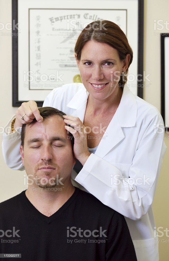 Acupuncturist and Patient stock photo