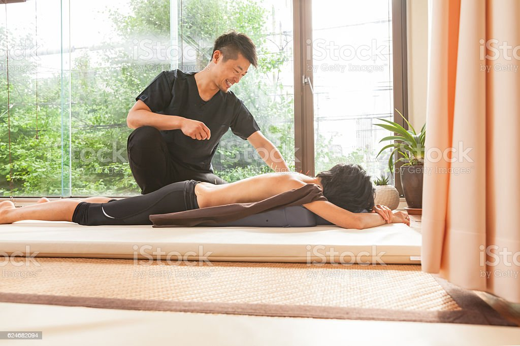 Acupuncturist at work stock photo