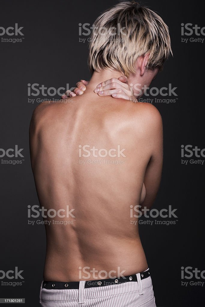 Acute pain in a neck at the young women stock photo