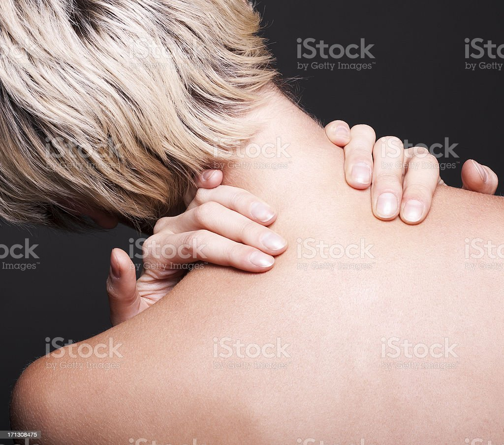 Acute pain in a neck at the young women royalty-free stock photo