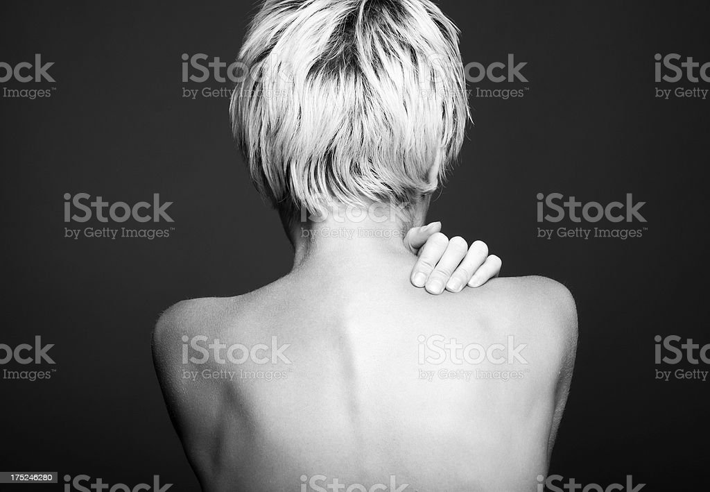 Acute pain in a neck at the young women. stock photo