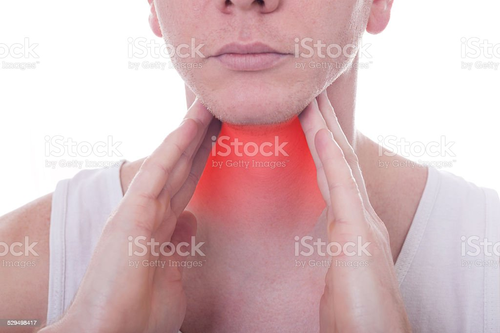 Acute pain in a throat at the young man stock photo