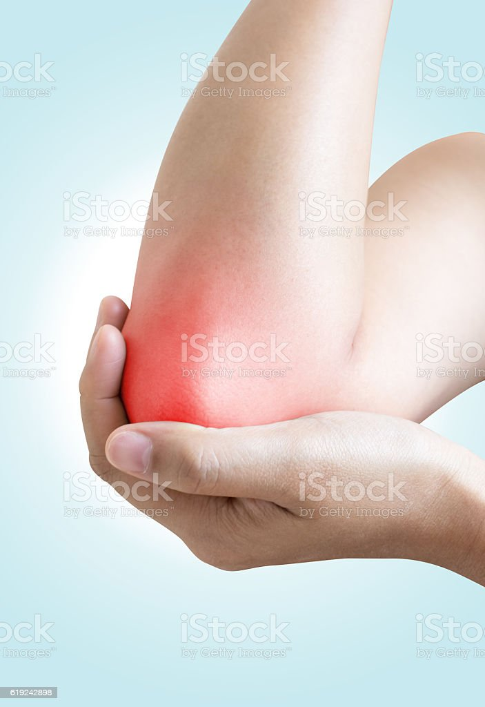 Acute pain in a woman elbow stock photo