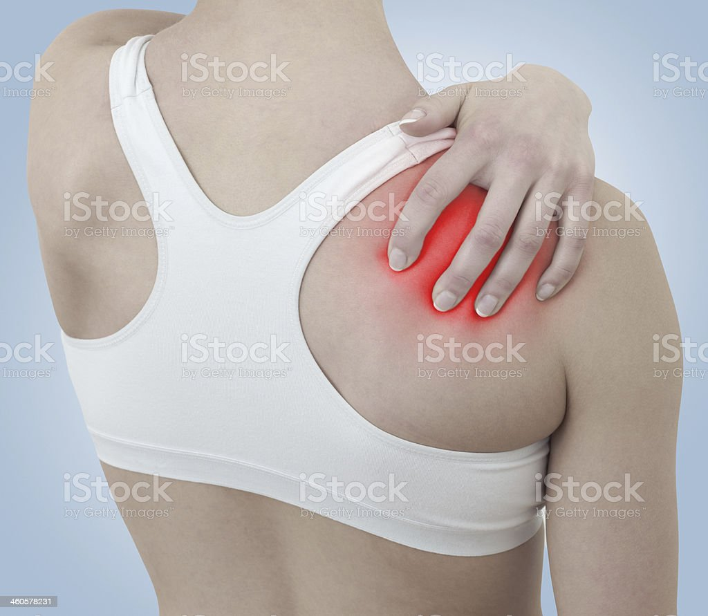 Acute pain in a woman shoulder royalty-free stock photo
