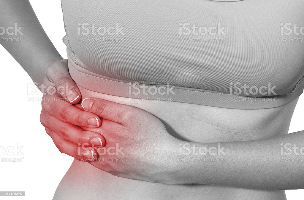 Acute pain in a woman stomach royalty-free stock photo