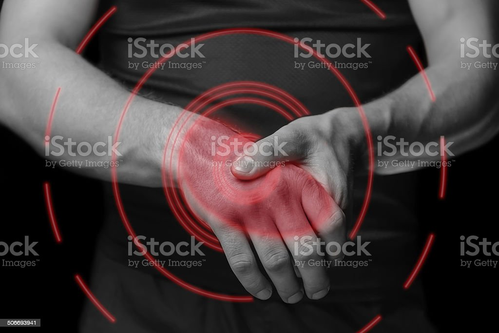Acute pain in a wrist, painful area of red color stock photo