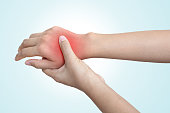 Acute pain in hand of a woman or man