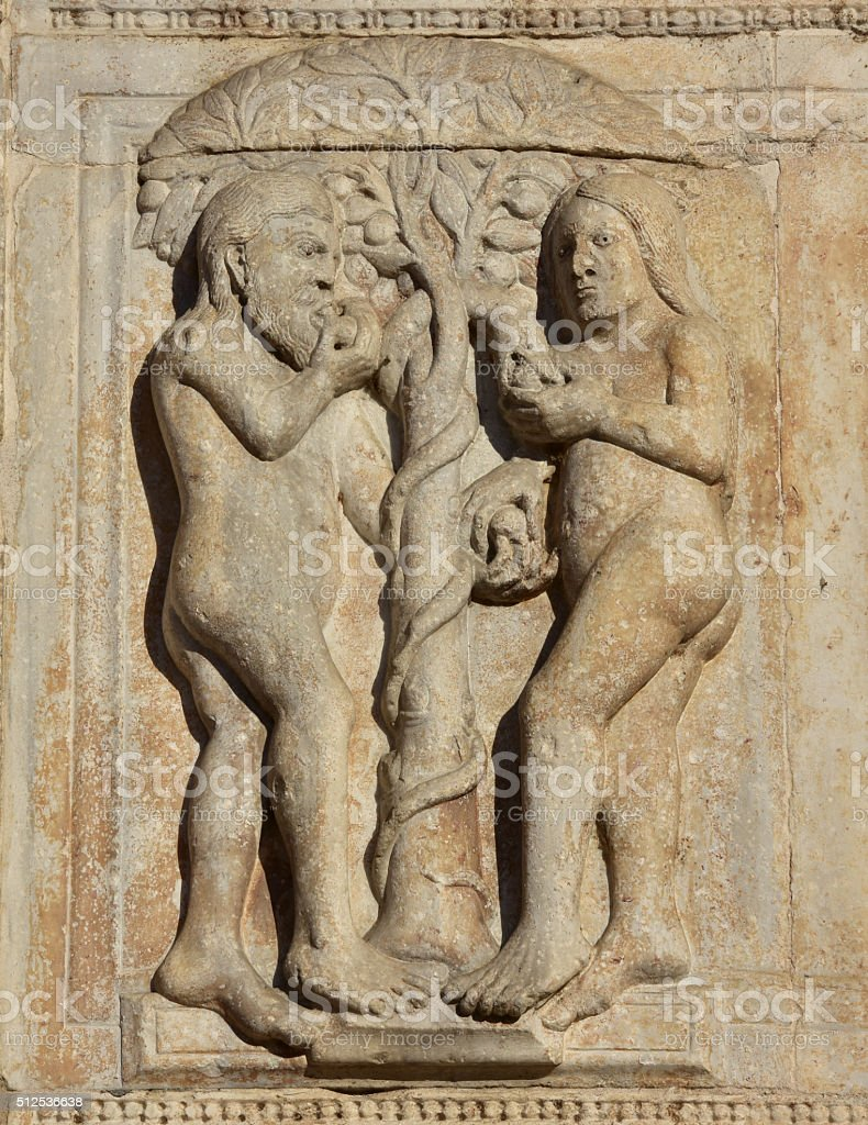 Adam and Eve eat the fruit of the forbidden tree stock photo