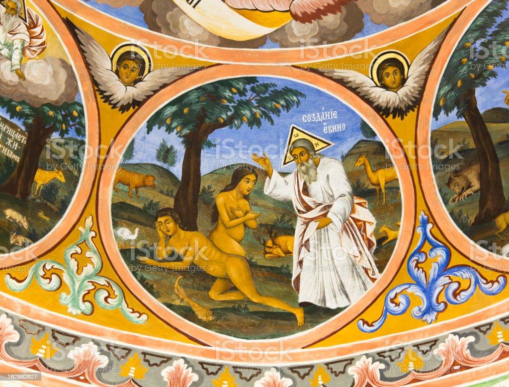Adam, Eve and God in the Garden of Eden. stock photo