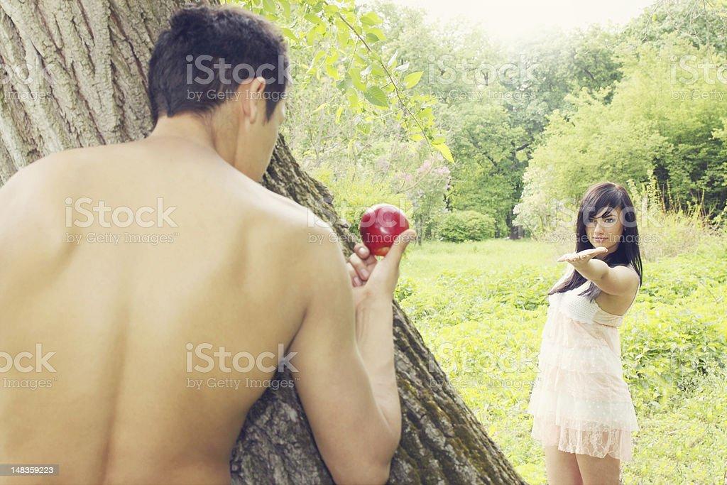 Adam holds apple stock photo