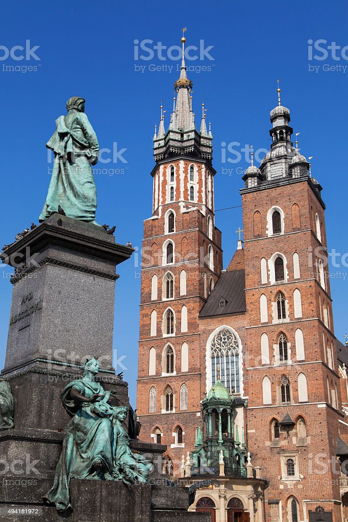 Adam Mickiewicz statue and Saint Mary Basilica stock photo