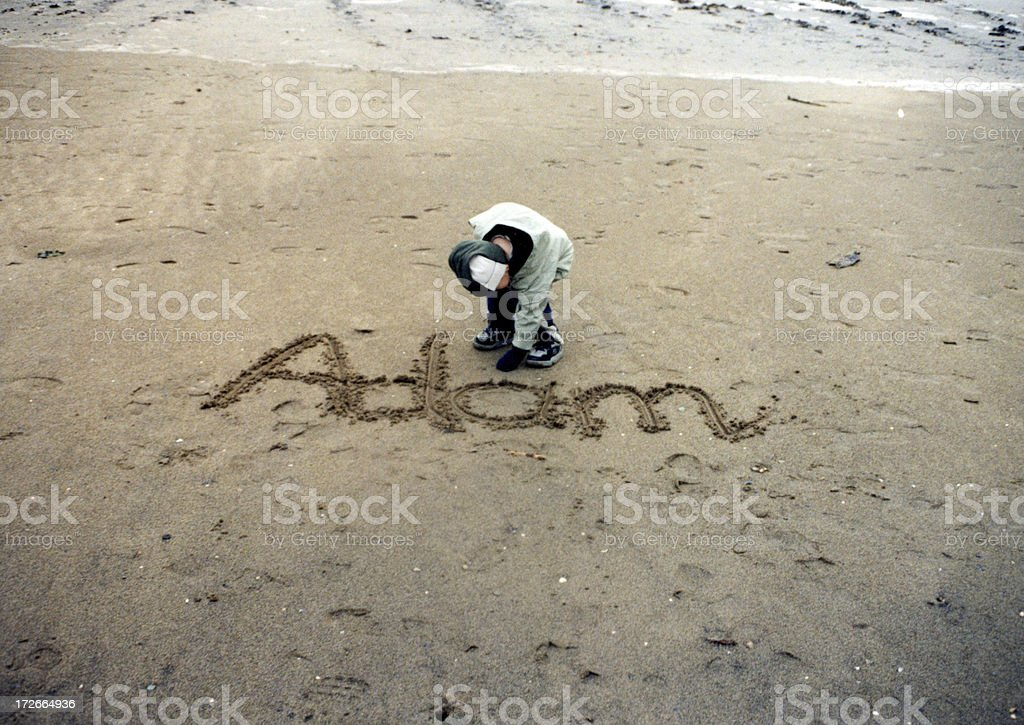 Adam - Writing in the sand royalty-free stock photo