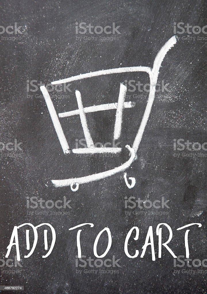 add to cart sign on blackboard stock photo