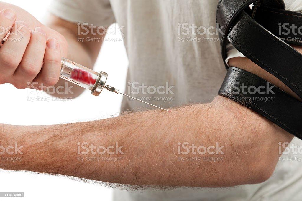 Addict injecting syringe stock photo