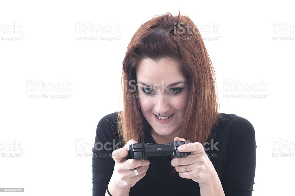Addicted playing girl with a game controller royalty-free stock photo