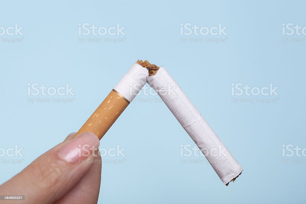 Addiction. Broken cigarette in hand. Quit smoking royalty-free stock photo