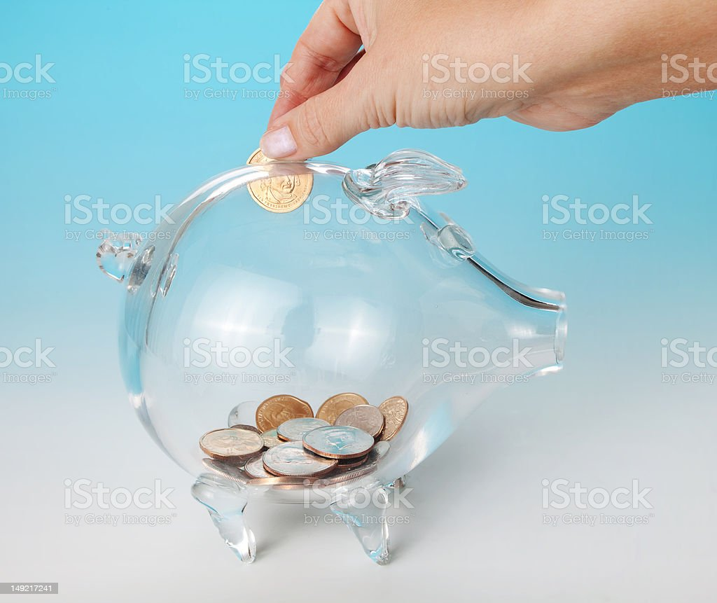Adding a coin royalty-free stock photo