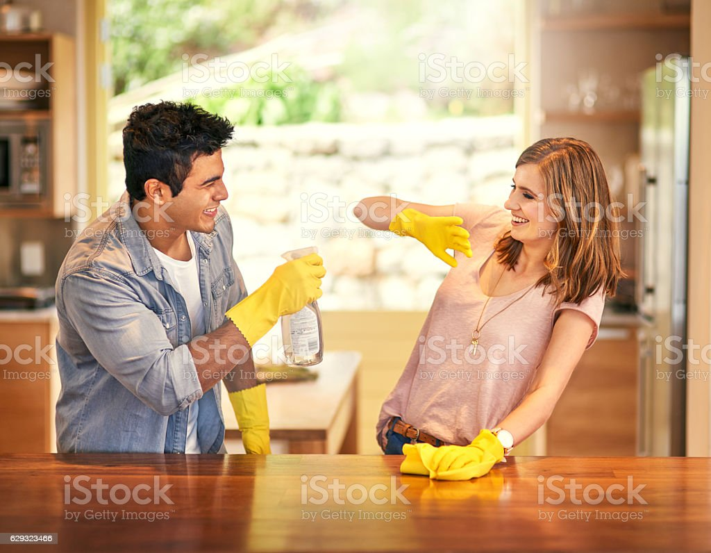 Adding a little fun to their housework stock photo