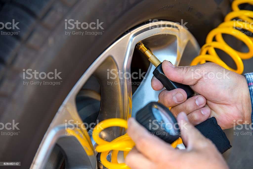 Adding Air to Tire stock photo