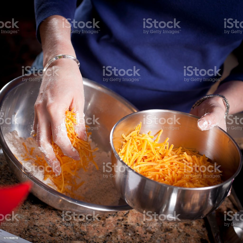 Adding Cheese While Baking royalty-free stock photo