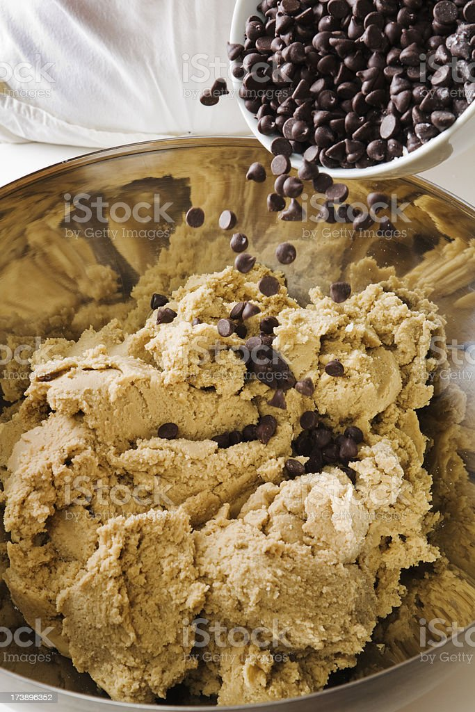 Adding Chocolate Chips to Cookie Dough royalty-free stock photo