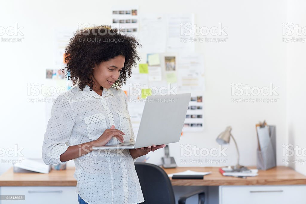 Adding her designs to the company's website stock photo