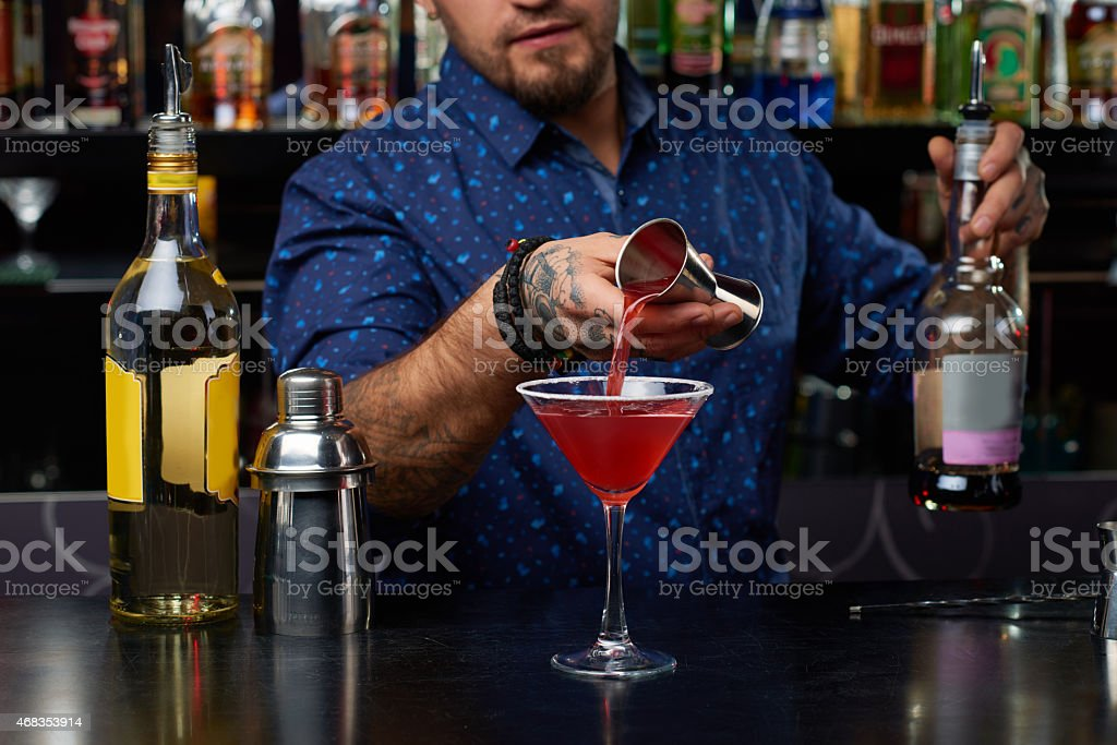 Adding liqueur stock photo