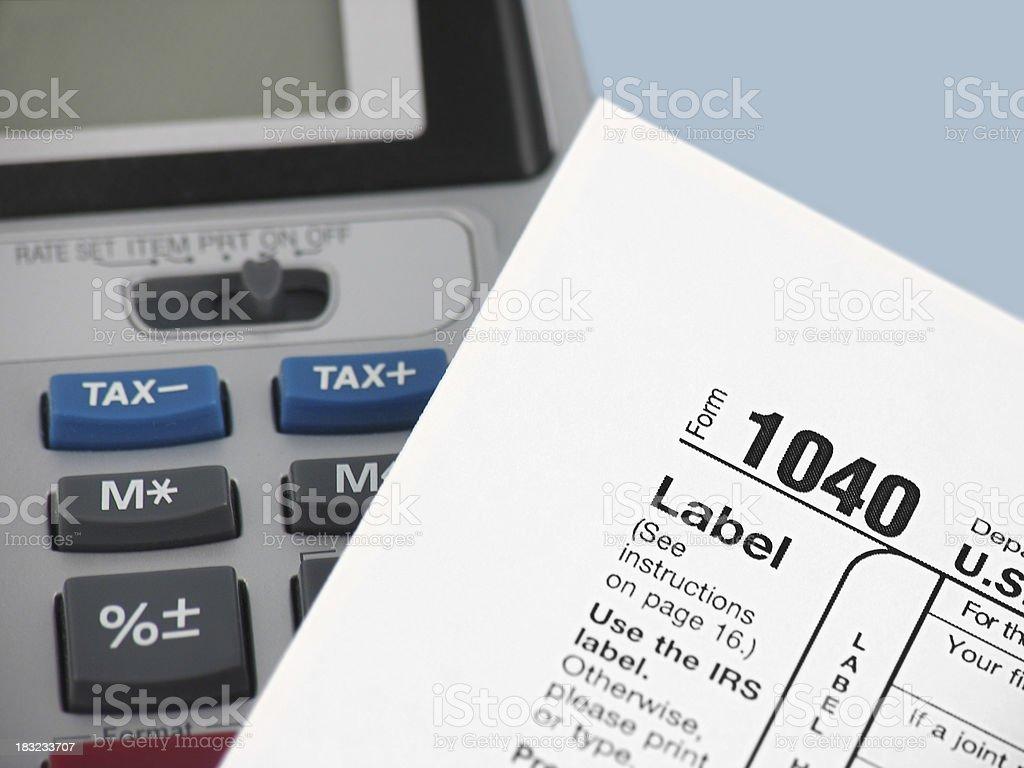 Adding Machine and 1040 Tax Form stock photo