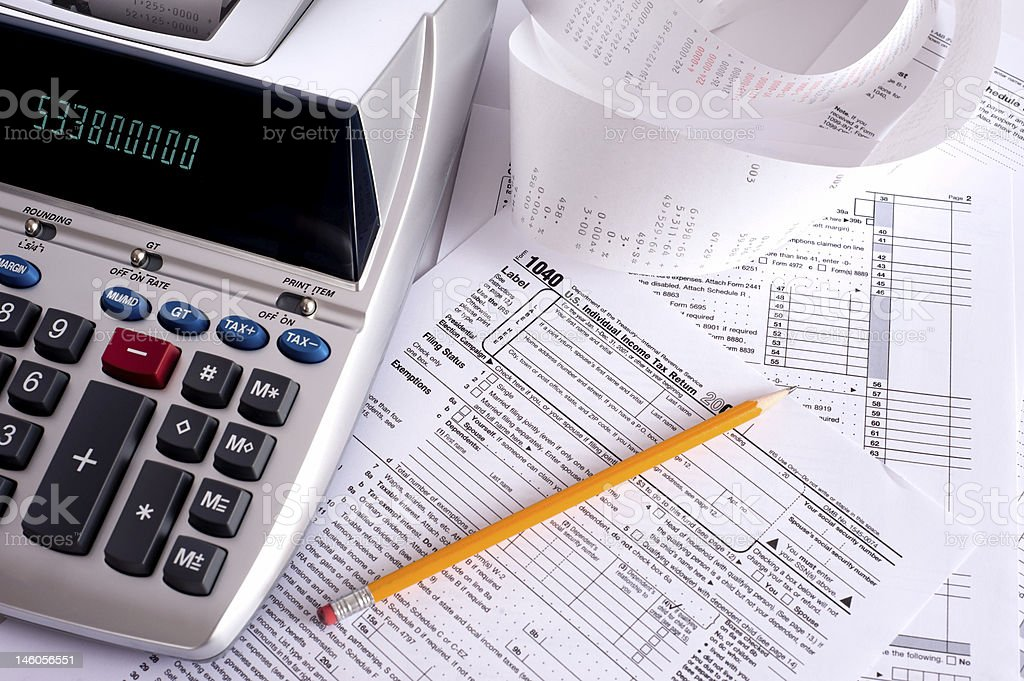 Adding Machine with tax forms stock photo
