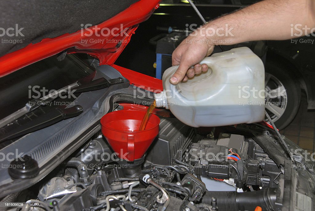 Adding Oil to a Car royalty-free stock photo