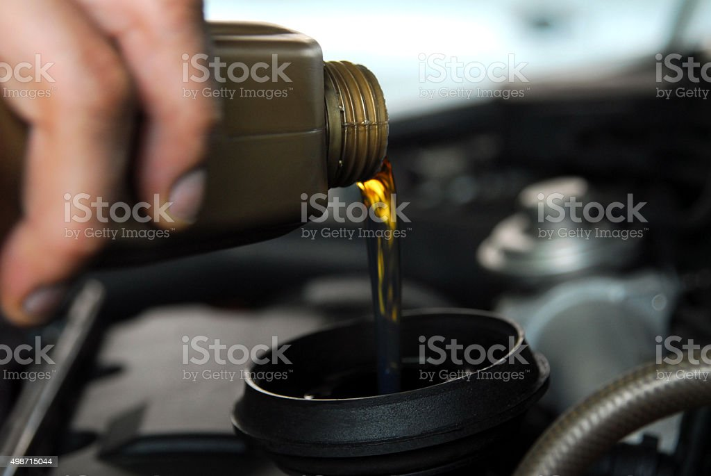 Adding Oil to a Car stock photo