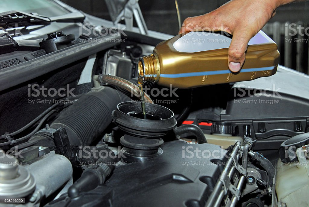 Adding Oil to a Car stock photo