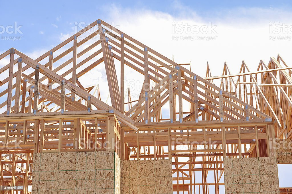 Adding roof to new construction home stock photo