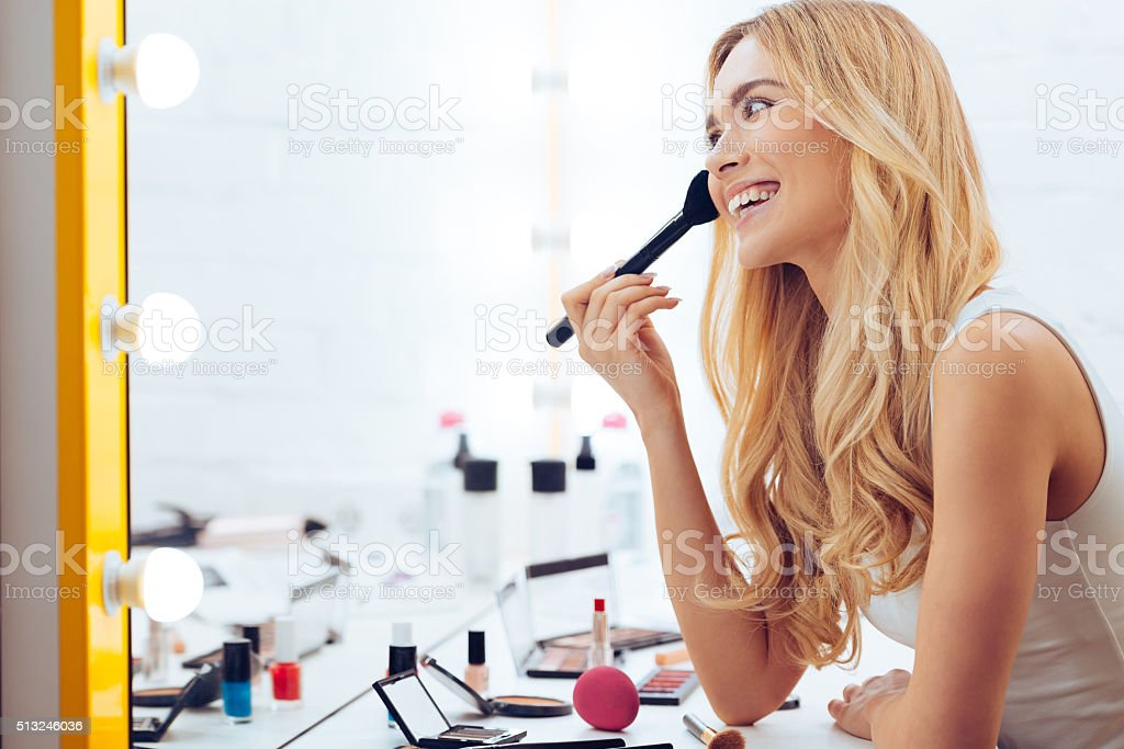 Adding some color to my cheeks. stock photo