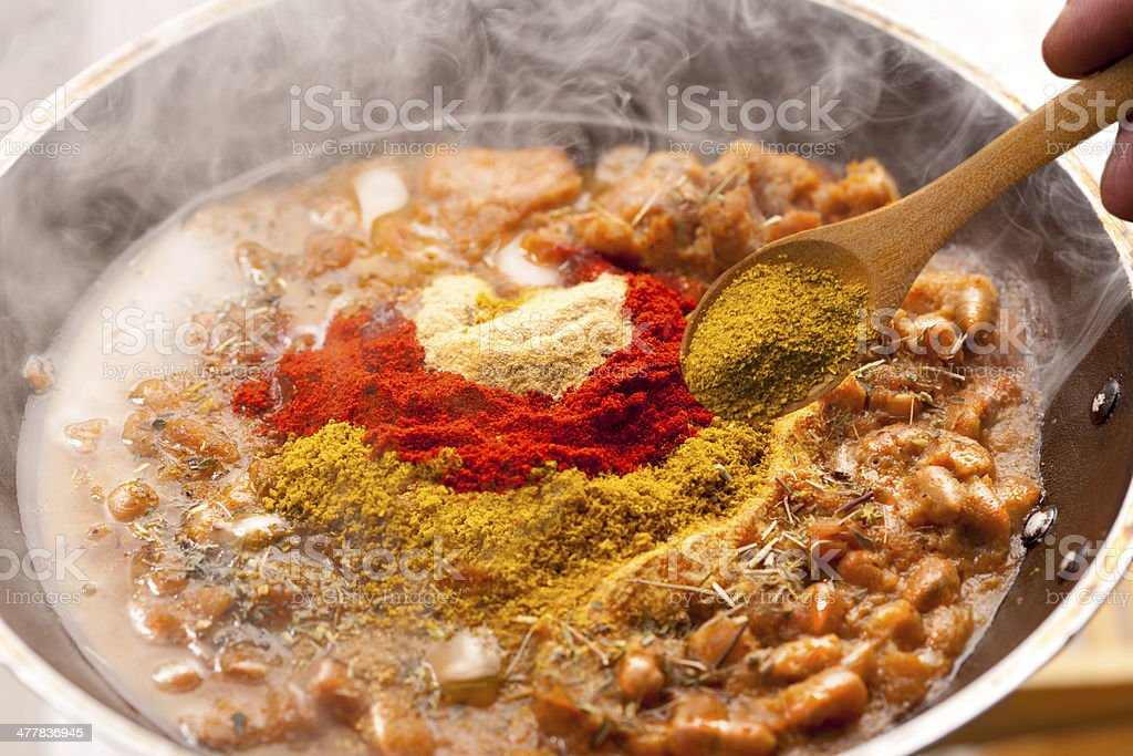 Adding spices royalty-free stock photo