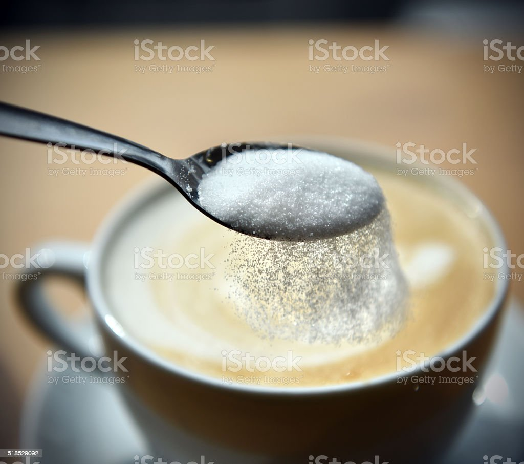 Adding Sugar stock photo