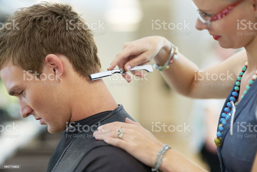 Adding the finishing touches to his hairstyle royalty-free stock photo