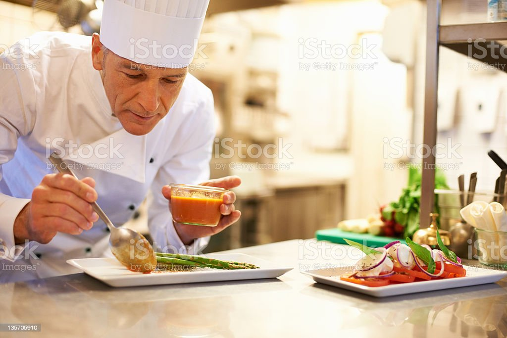 Adding the garnish to a lovely meal stock photo