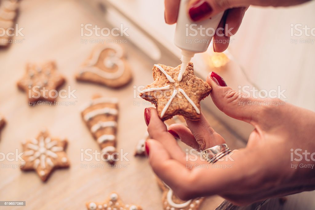Adding the Icing on Baked Christmas Cookies stock photo