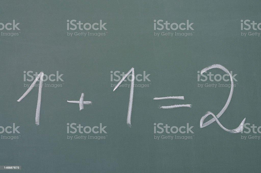 addition on chalkboard stock photo