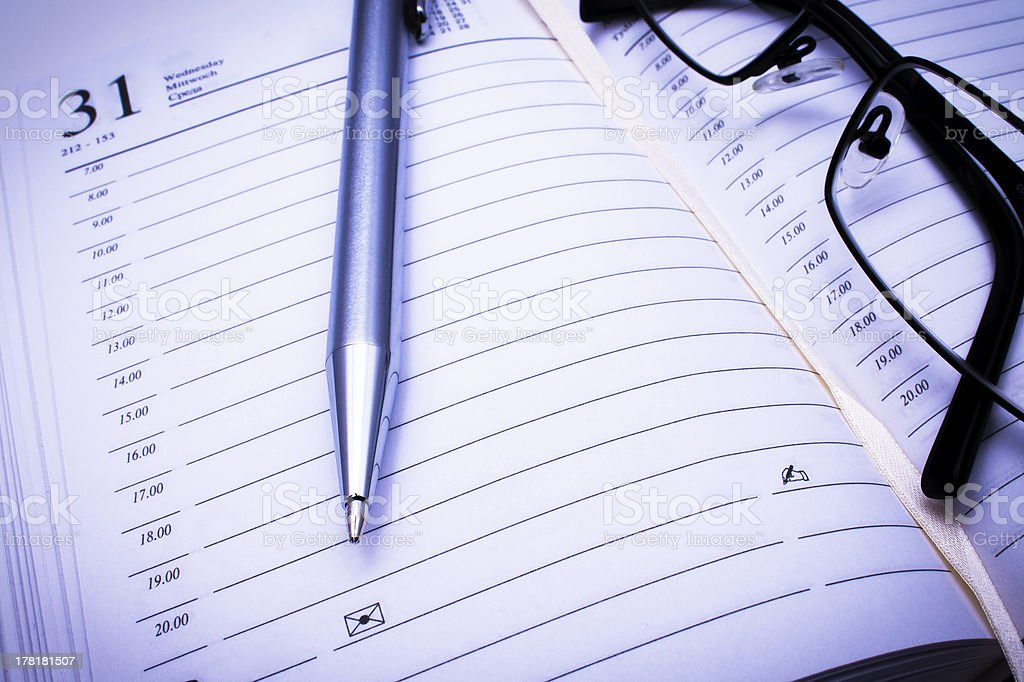 Address book, pen & black glasses stock photo