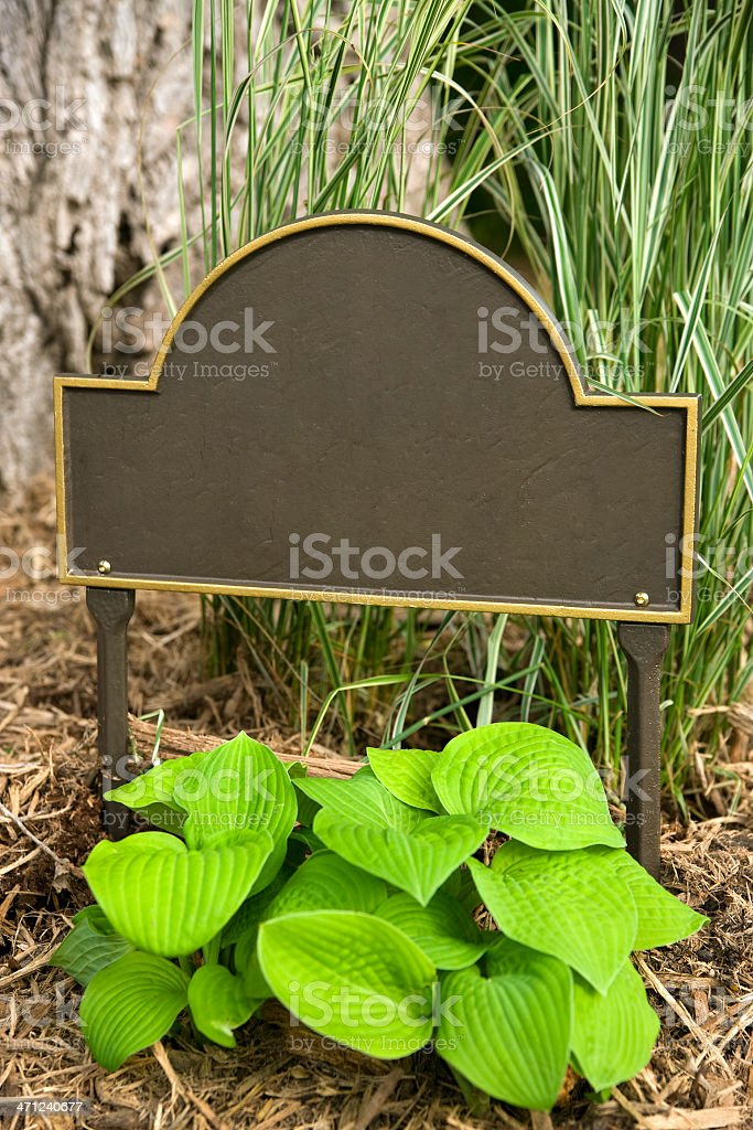 Address sign in garden. royalty-free stock photo