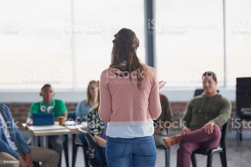 Addressing her group stock photo